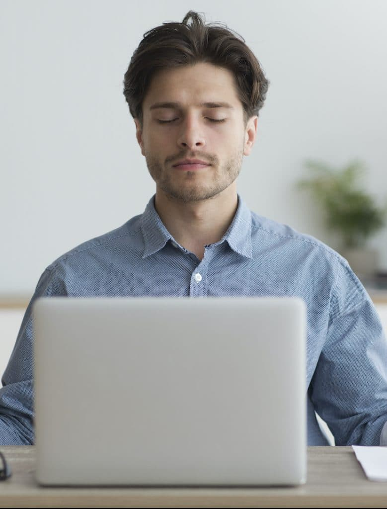 Man taking an Online Mindfulness-Based Stress Reduction course